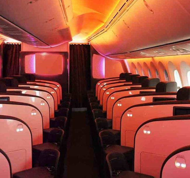 Airplane cabin with subtle red lighting
