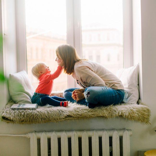 Mum and child on window seat